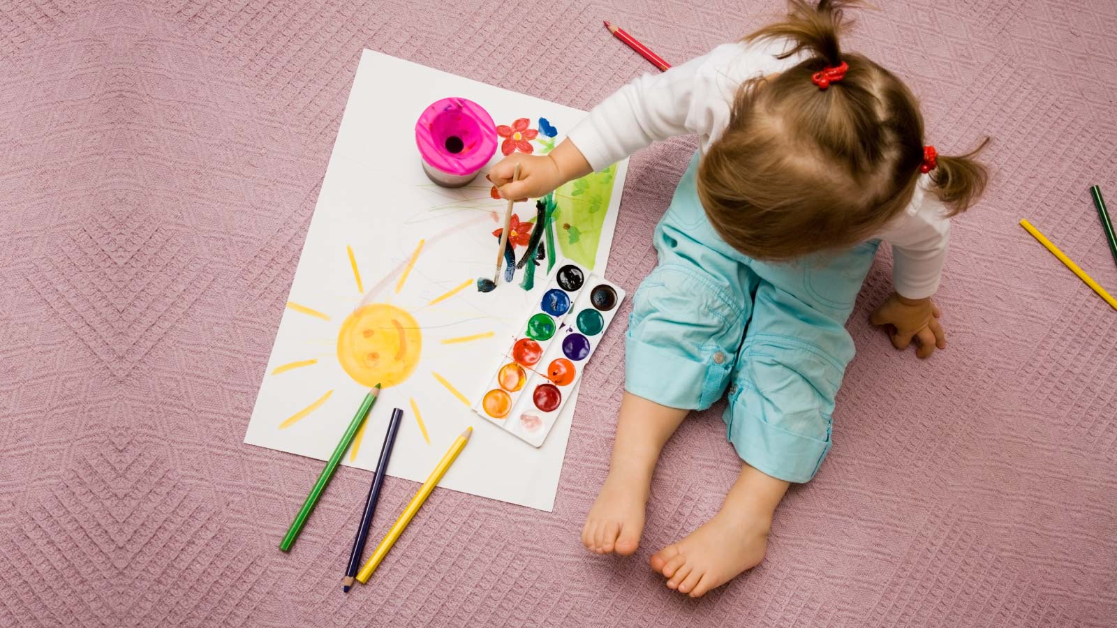 A child painting and listening to the music.