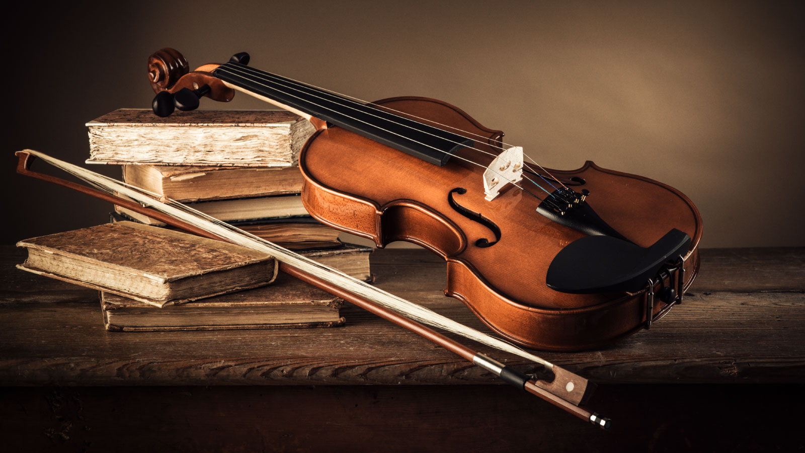 Classical violin with antique books.