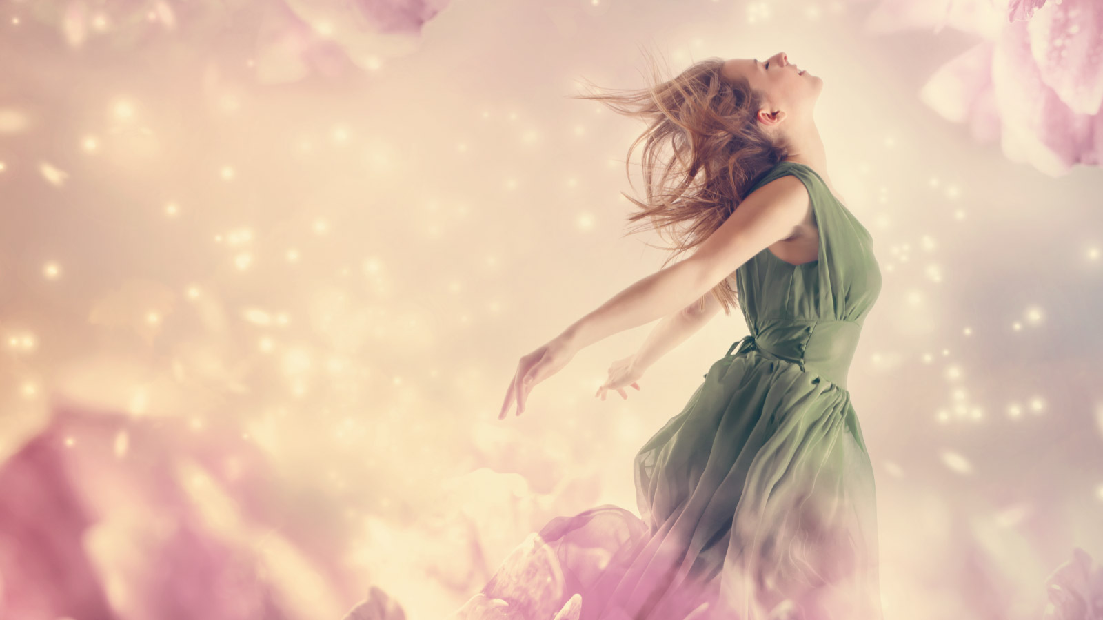 A girl easy flying over light flowers